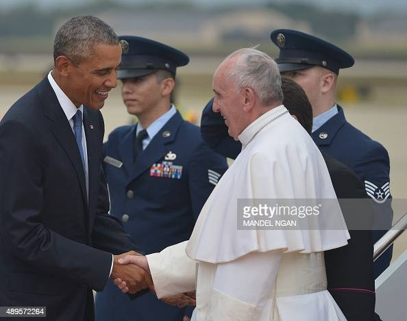US President Barack Obama greets Pope Francis upon his arrival September 22 2015 at Andrews Air Force Base in Maryland AFP PHOTO/MANDEL NGAN
