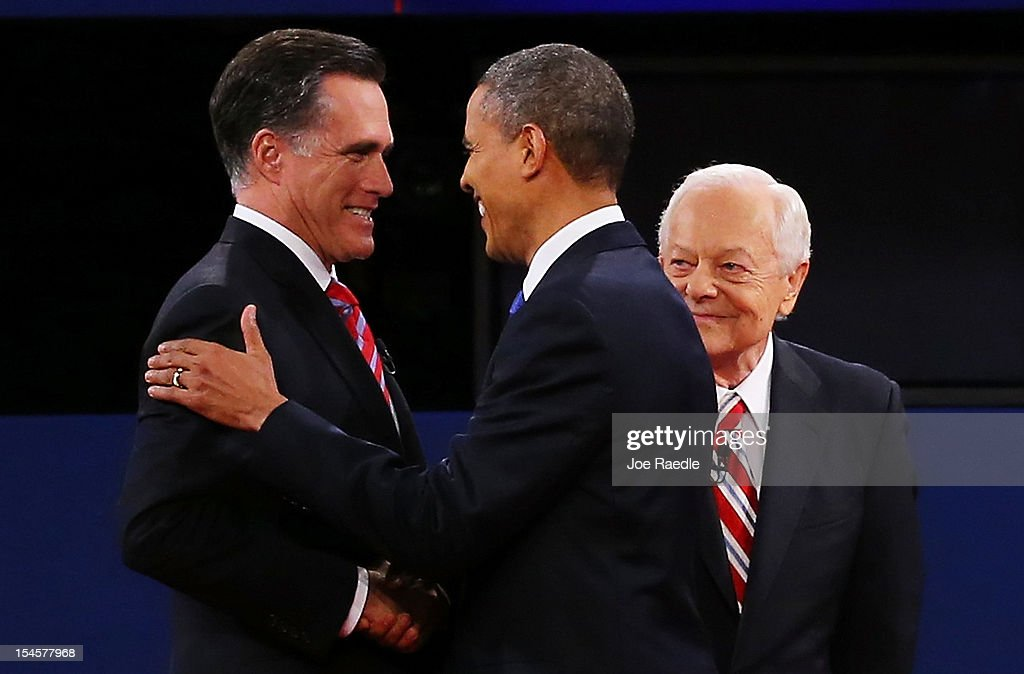 S President Barack Obama greets Republican presidential candidate Mitt Romney as moderator Bob Schieffer of CBS looks on prior to their debate at the...