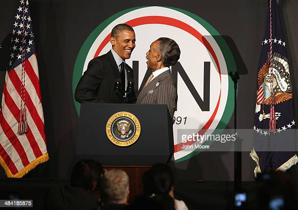 President Barack Obama greets Rev Al Sharpton president of the National Action Network at their 16th annual convention at the Sheraton New York Times...