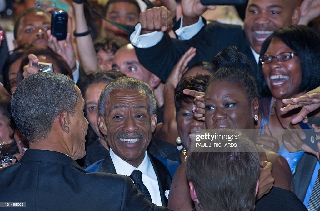 US President Barack Obama (L) greets Rev. Al Sharpton (C), Trayvon Martin's mother Sybrina Fulton (R), and others in the crowd after delivering remarks at the Congressional Black Caucus Foundation, Inc. (CBCF) Annual Phoenix Awards September 21, 2013 at the Washington Convention Center in Washington, DC. AFP Photo/Paul J. Richards