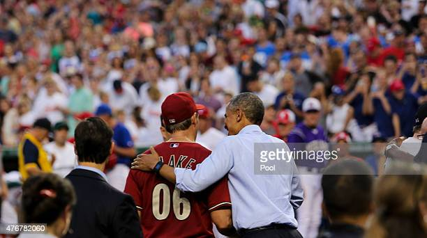 President Barack Obama greets Senator Jeff Flake during the 2015 Congressional Baseball Game at the National Parks Stadium on June 11 2015 in...