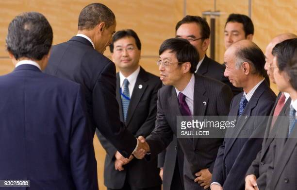 US President Barack Obama greets senior Japanese officials prior to meetings with Japanese Prime Minister Yukio Hatoyama at Kantei the Prime...