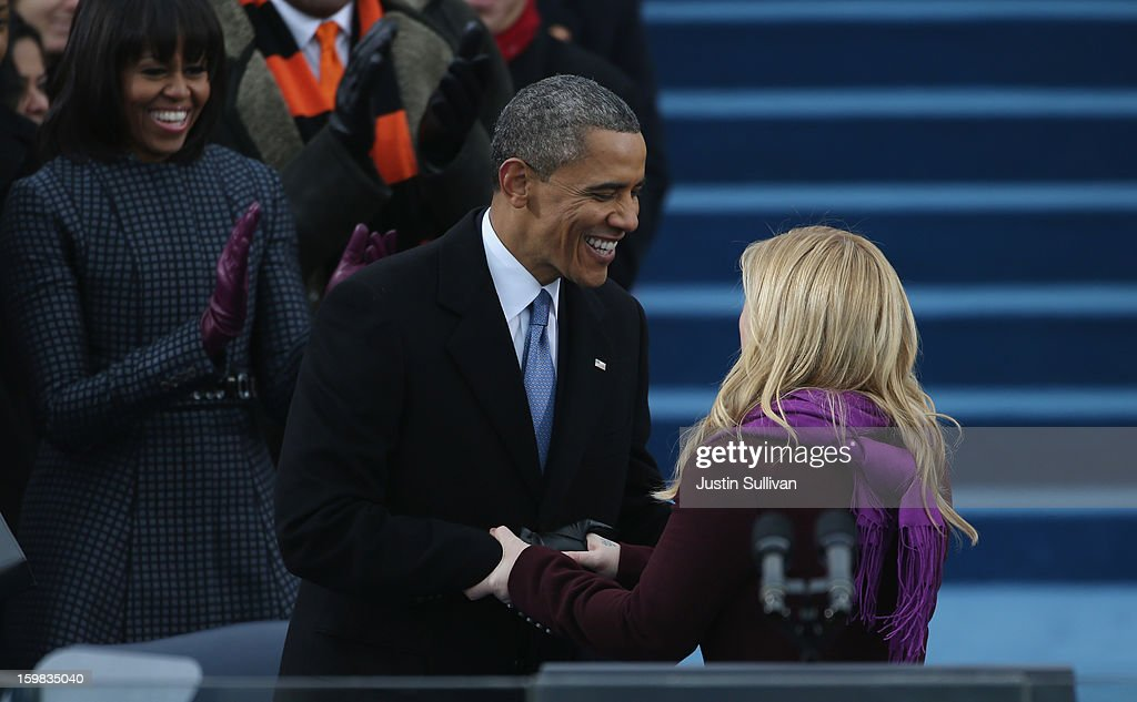 U.S. President Barack Obama greets singer Kelly Clarkson after her performance of 'My Country, 'Tis of Thee' during the public ceremonial inauguration on the West Front of the U.S. Capitol January 21, 2013 in Washington, DC. Barack Obama was re-elected for a second term as President of the United States.