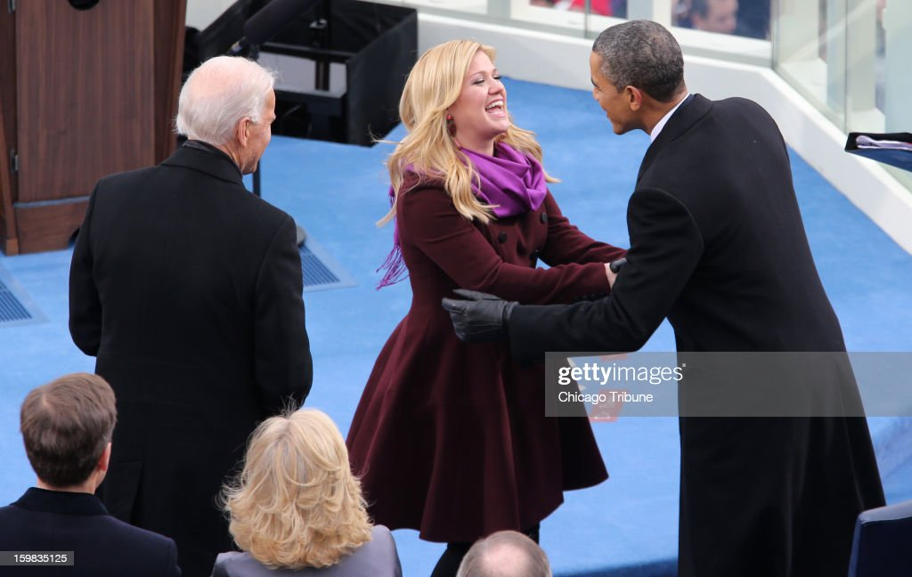 President Barack Obama greets singer Kelly Clarkson during inauguration ceremonies for Obama's second inauguration at the West Front of the U.S. Capitol in Washington, D.C., January 21, 2013.