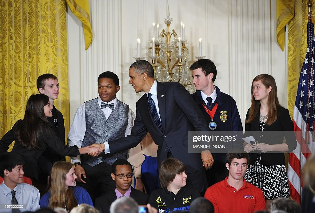 US President Barack Obama greets students after speaking at the White House science fair on April 23, 2013 in the East Room of the White House in Washington, DC. The event honours student winners of science, technology, engineering and math competitions from across the country. AFP PHOTO/Mandel NGAN