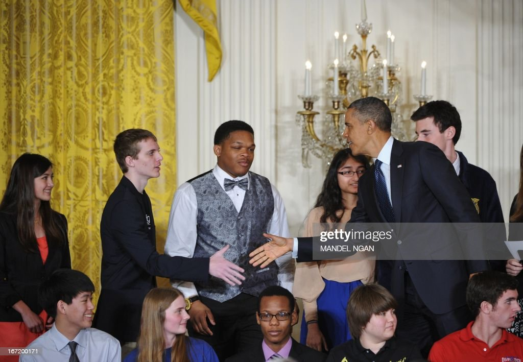 US President Barack Obama greets students during the White House science fair on April 23, 2013 in the East Room of the White House in Washington, DC. The event honours student winners of science, technology, engineering and math competitions from across the country. AFP PHOTO/Mandel NGAN