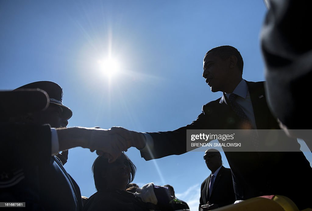 US President Barack Obama greets supporters after arriving at Dobbins Air Reserve Base February 14, 2013 in Decatur, Georgia. Obama is in Georgia to promote economic and educational initiatives he spoke about in this week's State of the Union. AFP PHOTO/Brendan SMIALOWSKI