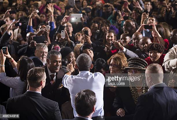 US President Barack Obama greets supporters after speaking at a Democratic campaign rally for US Senate candidate Gary Peters and candidate for...