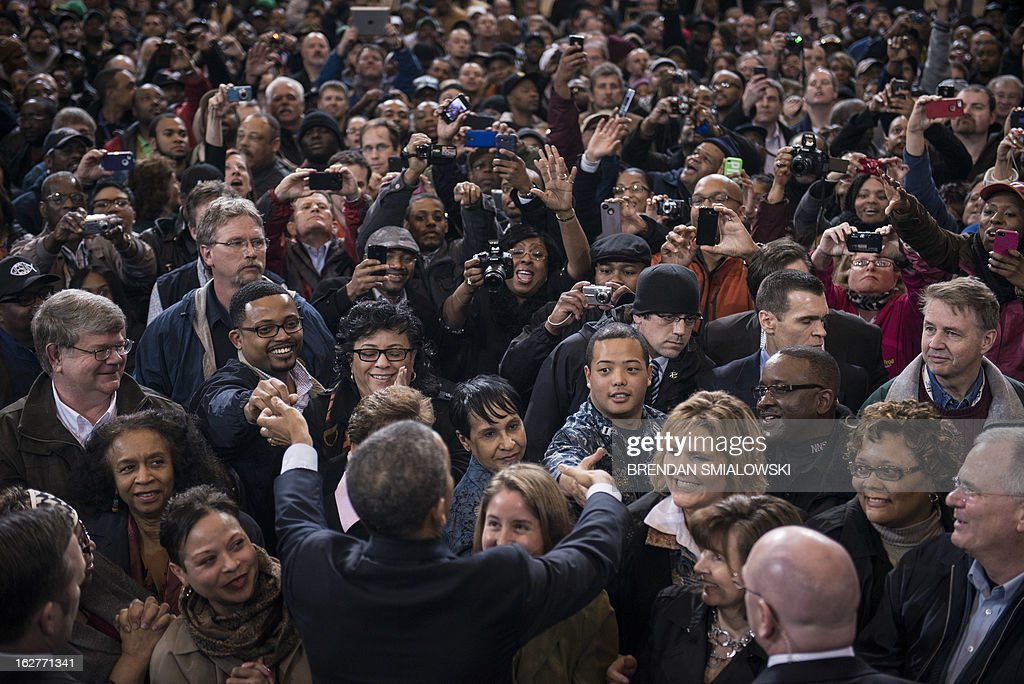 US President Barack Obama greets supporters after speaking at an event at Newport News Shipbuilding February 26, 2013 in Newport News, Virginia. Obama painted a devastating picture of looming government budget cuts, at a fabled shipbuilding yard in Virginia that provides the US Navy's nuclear powered aircraft carriers. The trip will intensify the president's effort to hike pressure on Republicans to agree on tax increases to avert $85 billion in automatic spending cuts this year, which experts warn could stagger the fragile economy. The White House said the cuts, known as 'the sequester' which are due to hit on March 1, would see 90,000 civilian defense workers furloughed in Virginia alone and would hurt companies in 50 states that supply shipbuilders. AFP PHOTO/Brendan SMIALOWSKI