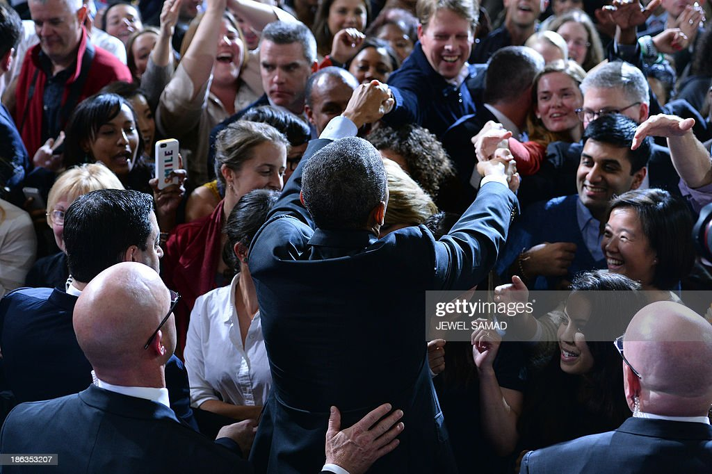 US President <a gi-track='captionPersonalityLinkClicked' href=/galleries/search?phrase=Barack+Obama&family=editorial&specificpeople=203260 ng-click='$event.stopPropagation()'>Barack Obama</a> greets supporters after speaking on healthcare at Faneuil Hall in Boston, Massachusetts, on October 30, 2013. Obama arrived in Boston to speak on the importance of providing all Americans with quality, affordable health insurance and the experience in Massachusetts, which passed its bipartisan health care law in 2006. AFP Photo/Jewel Samad