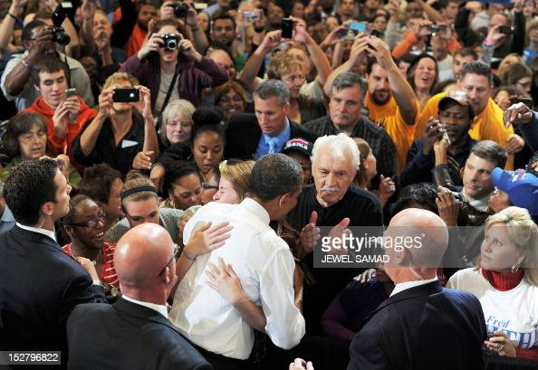 US President Barack Obama greets supporters during a campaign event at the Bowling Green State University on September 26 2012 in Bowling Green Ohio...
