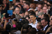 S President Barack Obama greets supporters during a campaign rally at the Delta Center on November 3 2012 in Milwaukee Wisconsin Wisconsin is one of...