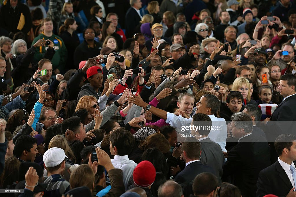 U.S. President Barack Obama greets supporters during a campaign rally on September 22, 2012 in Milwaukee, Wisconsin. In addition to the rally, Obama attended two fundraising events during his visit to Milwaukee.