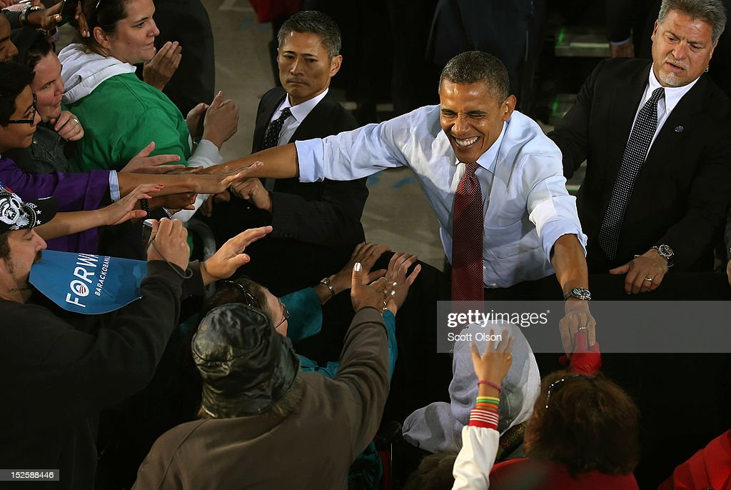 U.S. President <a gi-track='captionPersonalityLinkClicked' href=/galleries/search?phrase=Barack+Obama&family=editorial&specificpeople=203260 ng-click='$event.stopPropagation()'>Barack Obama</a> greets supporters during a campaign rally on September 22, 2012 in Milwaukee, Wisconsin. In addition to the rally, Obama attended two fundraising events during his visit to Milwaukee.