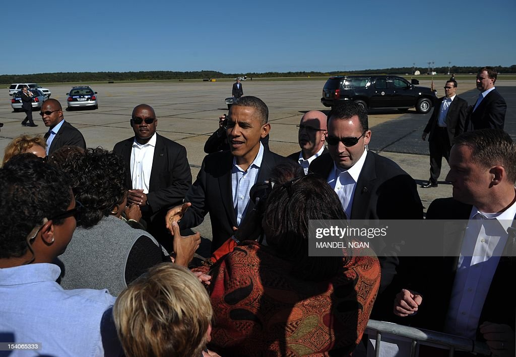 US President Barack Obama greets supporters on October 13, 2012 upon arrival at Newport News/ Williamsburg International Airport in Williamsburg, Virginia. Obama was heading to Williamsburg, Virginia to prepare for the second presidential debate on October 16 in Hempstead, NY. AFP PHOTO/Mandel NGAN