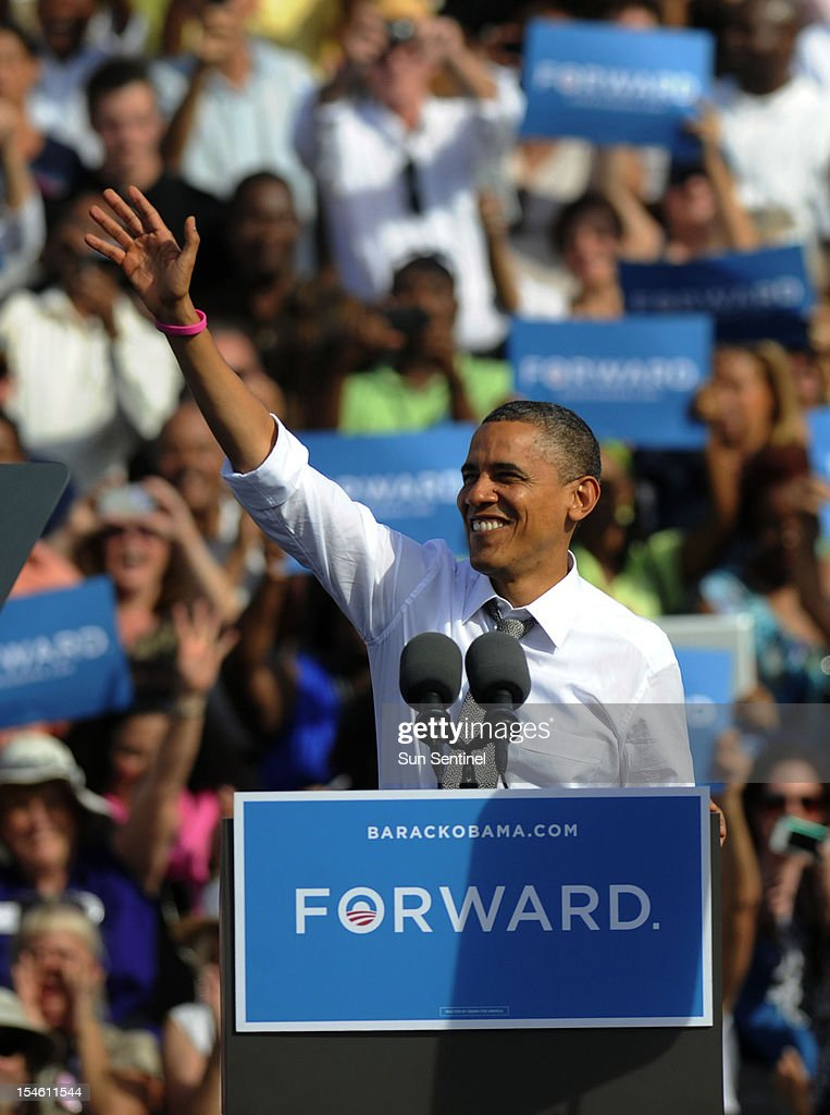 President Barack Obama greets supporters with a wave in Delray Beach, Florida, Tuesday, October 23, 2012, the morning after the third and final presidential debate held at Lynn University in Boca Raton. Several thousand supporters filled the Delray Beach Tennis Center to hear the President speak at what the campaign called a Grassroots Event.