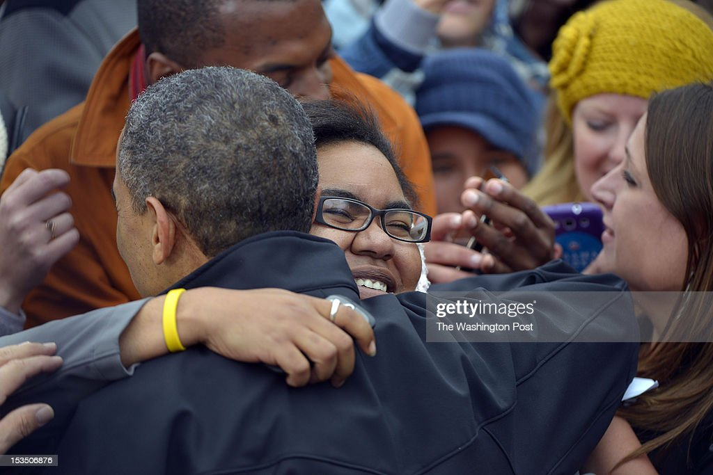 President Barack Obama greets supporters with hugs and handshakes after delivering remarks at a campaign event at Sloan's Lake Park in Denver, Colorado on October 04, 2012. Marvin Joseph/The Washington Post via Getty Images)