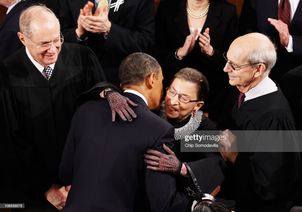 President <a gi-track='captionPersonalityLinkClicked' href=/galleries/search?phrase=Barack+Obama&family=editorial&specificpeople=203260 ng-click='$event.stopPropagation()'>Barack Obama</a> (C) greets (L-R) Supreme Court Justices <a gi-track='captionPersonalityLinkClicked' href=/galleries/search?phrase=Anthony+Kennedy&family=editorial&specificpeople=220874 ng-click='$event.stopPropagation()'>Anthony Kennedy</a>, <a gi-track='captionPersonalityLinkClicked' href=/galleries/search?phrase=Ruth+Bader+Ginsburg&family=editorial&specificpeople=199152 ng-click='$event.stopPropagation()'>Ruth Bader Ginsburg</a> and <a gi-track='captionPersonalityLinkClicked' href=/galleries/search?phrase=Stephen+Breyer&family=editorial&specificpeople=227411 ng-click='$event.stopPropagation()'>Stephen Breyer</a> before the State of the Union address on Capitol Hill on January 25, 2011 in Washington, DC. During his speech Obama was expected to focus on the U.S. economy and increasing education and infrastructure funding while proposing a three-year partial freeze of domestic programs and $78 billion in military spending cuts.