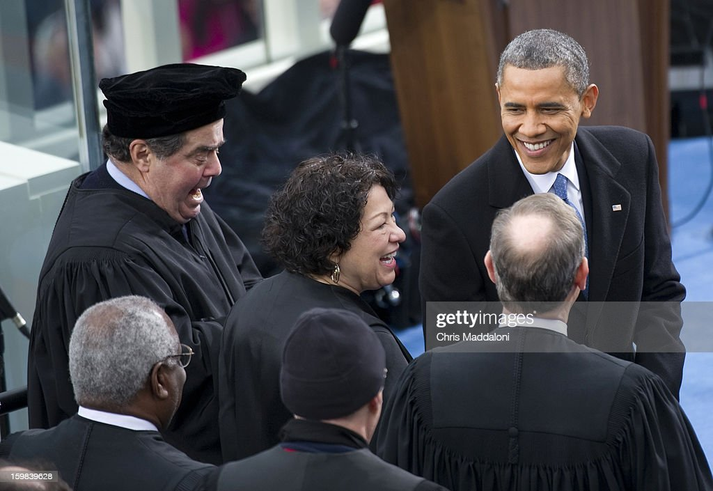 U.S. President Barack Obama greets Supreme Court Justices (L-R) Clarence Thomas; Antonin Scalia; Sonia Sotomayor; Anthony Kennedy; and John Roberts at the inauguration for U.S. President Barack Obama's second term of office. More than 600,000 people attended the event.