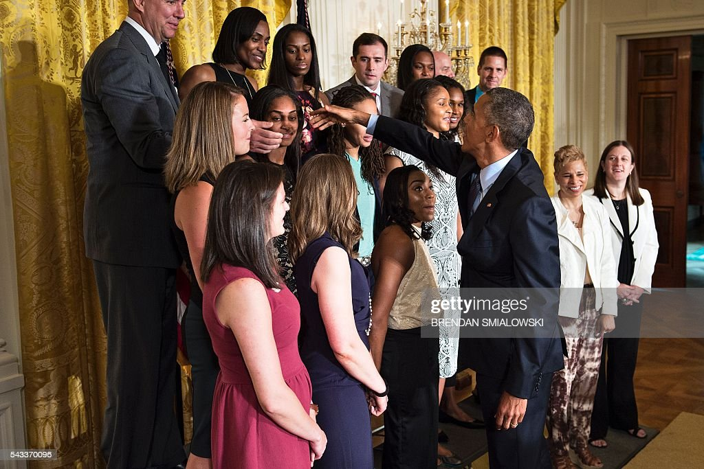 US President Barack Obama greets team members during an event to celebrate the 2015 WNBA Champions, Minnesota Lynx, in the East Room of the White House June 27, 2016 in Washington, DC. / AFP / Brendan Smialowski