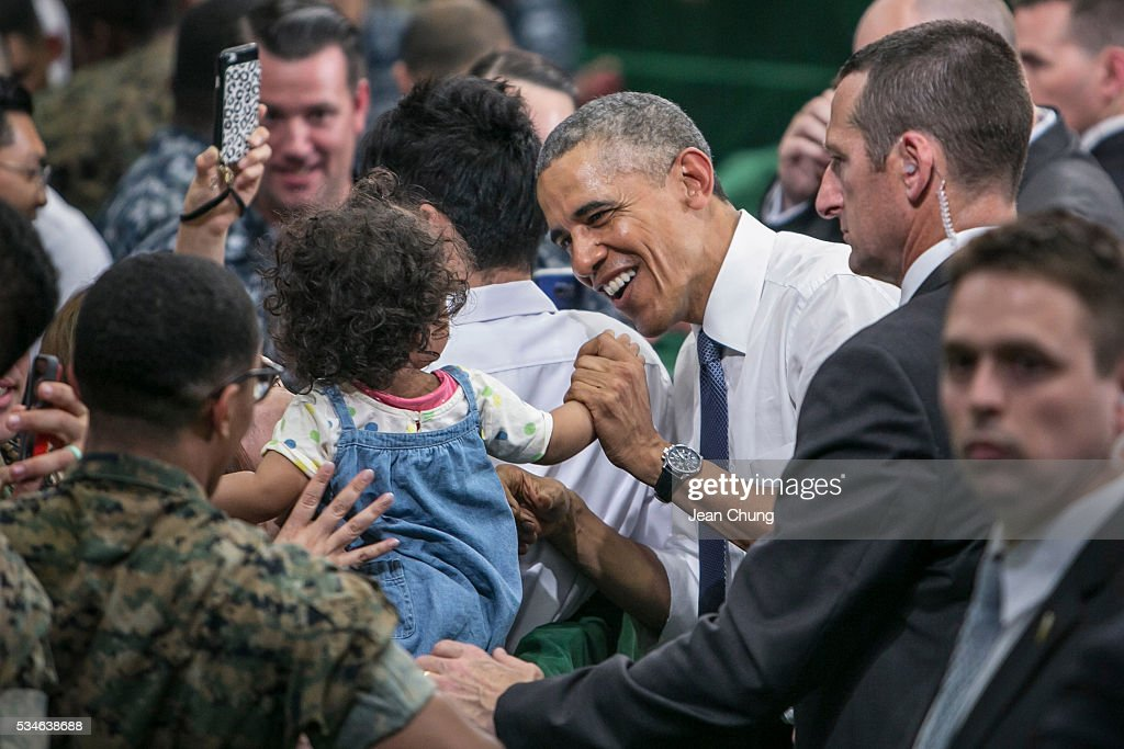 U.S. President <a gi-track='captionPersonalityLinkClicked' href=/galleries/search?phrase=Barack+Obama&family=editorial&specificpeople=203260 ng-click='$event.stopPropagation()'>Barack Obama</a> greets the cheering crowd of the U.S. and Japanese servicemen and their families at the Marine Corps Air Station Iwakuni (MCAS Iwakuni) on May 27, 2016 in Iwakuni, Japan. President <a gi-track='captionPersonalityLinkClicked' href=/galleries/search?phrase=Barack+Obama&family=editorial&specificpeople=203260 ng-click='$event.stopPropagation()'>Barack Obama</a> flew in to the MCAS Iwakuni on Air Force One, and visited the troops before visiting Hiroshima.