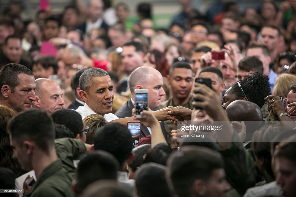 U.S. President Barack Obama greets the cheering crowd of the U.S. and Japanese servicemen and their families at the Marine Corps Air Station Iwakuni (MCAS Iwakuni) on May 27, 2016 in Iwakuni, Japan. President Barack Obama flew in to the MCAS Iwakuni on Air Force One, and visited the troops before visiting Hiroshima.