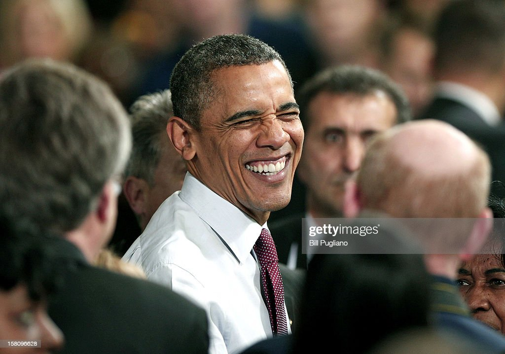 U.S. President <a gi-track='captionPersonalityLinkClicked' href=/galleries/search?phrase=Barack+Obama&family=editorial&specificpeople=203260 ng-click='$event.stopPropagation()'>Barack Obama</a> greets the crowd after he spoke about the economy at the Daimler Detroit Diesel engine plant December 10, 2012 in Redford, Michigan. The President and Congress have not yet come to an agreement regarding how to extend the Bush-era tax cuts, which expire at the end of this year (the so-called 'fiscal cliff'). Republicans in Congress want the tax cuts to continue to apply to all tax payers, whereas the President wants them to apply only to tax payers who earn less than $250,000 a year.