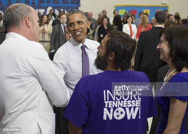 US President Barack Obama greets the crowd after speaking about the Affordable Care Act known as Obamacare at Taylor Stratton Elementary School in...