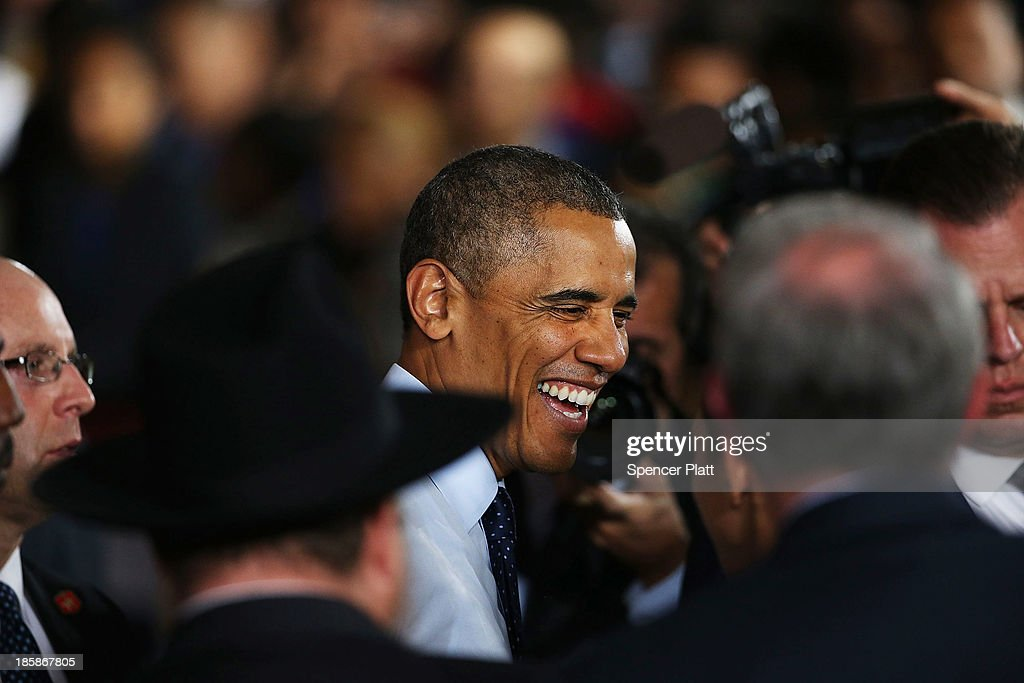 U.S. President <a gi-track='captionPersonalityLinkClicked' href=/galleries/search?phrase=Barack+Obama&family=editorial&specificpeople=203260 ng-click='$event.stopPropagation()'>Barack Obama</a> greets the crowd after speaking at the Pathways in Technology Early College High School in the Crown Heights section of Brooklyn on October 25, 2013 in New York City. President Obama had mentioned the school in a part of Brooklyn that's struggled with poverty and violence during his State of the Union address in February. While in New York Obama will also attend events to raise money for the Democratic National Committee and Democratic Congressional Campaign Committee.
