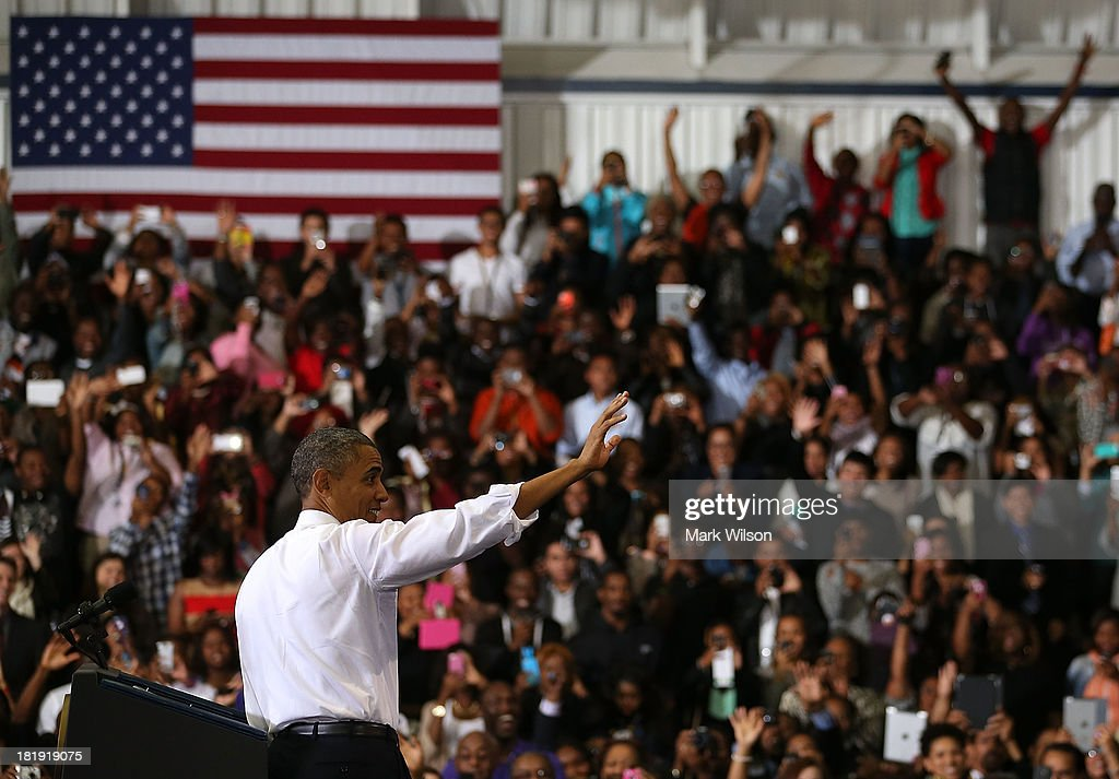U.S. President <a gi-track='captionPersonalityLinkClicked' href=/galleries/search?phrase=Barack+Obama&family=editorial&specificpeople=203260 ng-click='$event.stopPropagation()'>Barack Obama</a> greets the crowd before speaking at the Prince Georges Community College, September 26, 2013 in Largo, MD. President Obama spoke about the benefits of the Affordable Healthcare Act (ObamaCare) that will become available next month.
