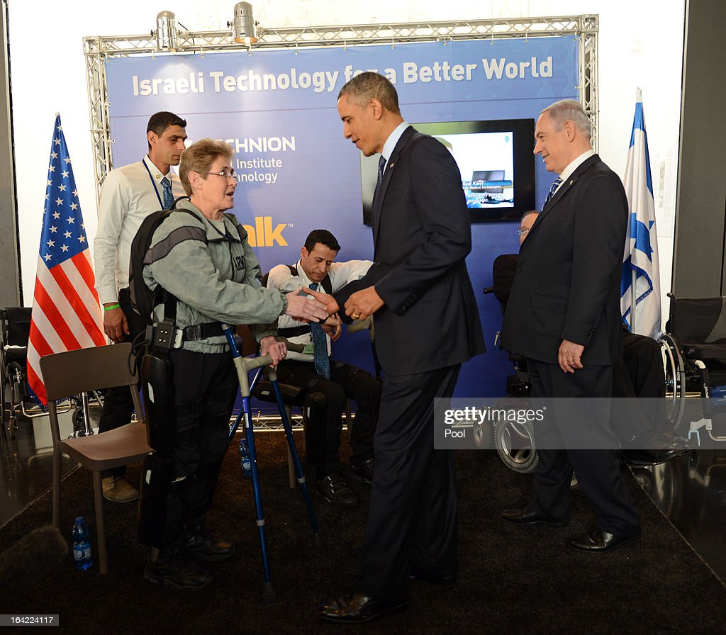 U.S. President Barack Obama greets Theresa Hannigan from New York, who is wearing a ReWalk bionic walking assistance system, at an Israeli technology exhibition at the Israel Museum on March 21, 2013 in Jerusalem, Israel. This is President Obama's first visit as president to the region, and his itinerary includes meetings with the Palestinian and Israeli leaders as well as a visit to the Church of the Nativity in Bethlehem.