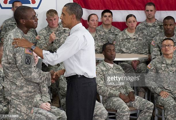 US President Barack Obama greets US Army soldiers from the 10th Mountain Division at Fort Drum New York June 23 2011 Obama has announced that 10000...