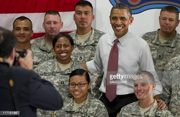 US President Barack Obama greets US Army soldiers from the 10th Mountain Division at Fort Drum New York on June 23 2011 Obama has announced that...