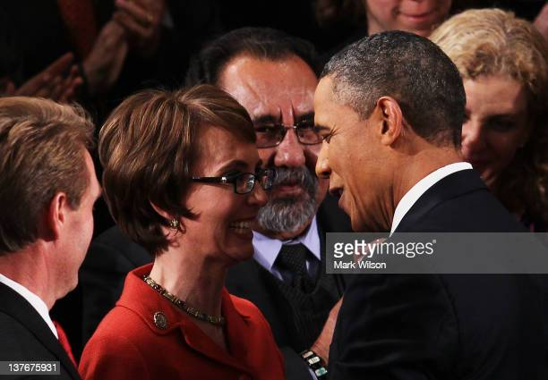 S President Barack Obama greets US Rep Gabrielle Giffords before delivering his State of the Union address on January 24 2012 in Washington DC Obama...