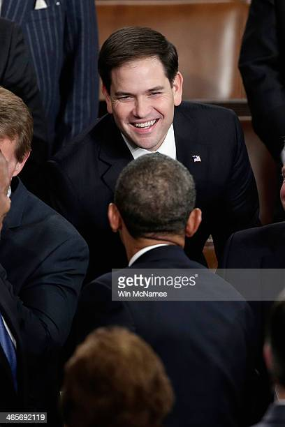 S President Barack Obama greets US Sen Marco Rubio before delivering the State of the Union address to a joint session of Congress in the House...