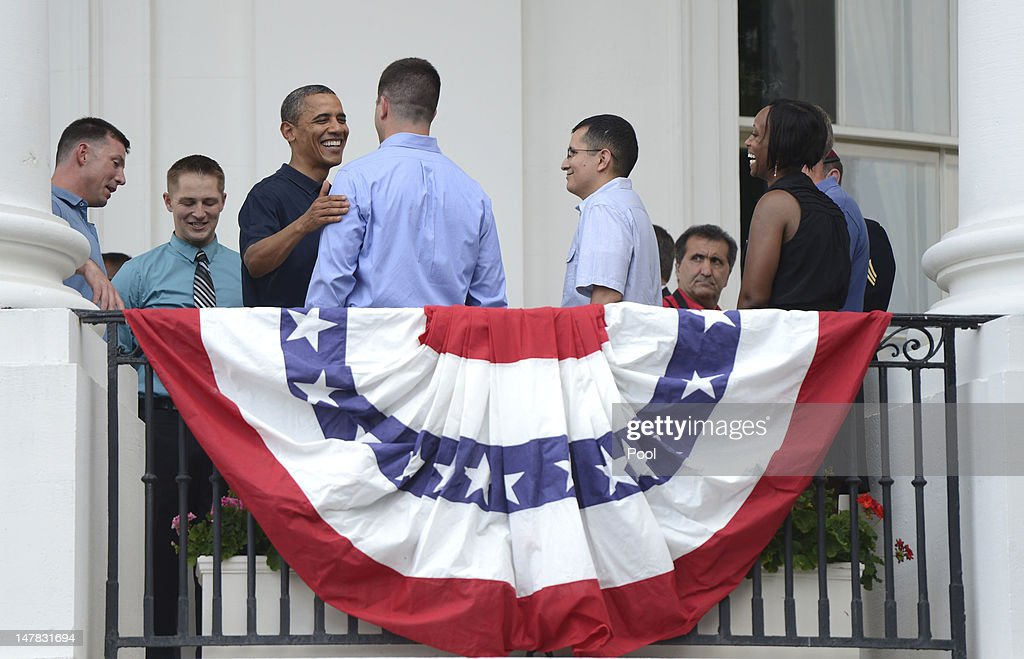 U.S. President <a gi-track='captionPersonalityLinkClicked' href=/galleries/search?phrase=Barack+Obama&family=editorial&specificpeople=203260 ng-click='$event.stopPropagation()'>Barack Obama</a> greets U.S. service members after delivering remarks to an Independence Day picinic on the South Lawn of the White House on July 4, 2012 in Washington, D.C. On this Independence Day President Obama is hosting a 4th of July celebration picnic on the South Lawn for White House staff and US service members.