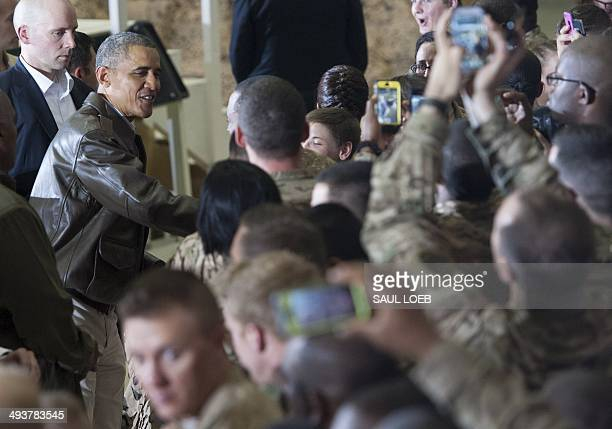US President Barack Obama greets US troops during a surprise visit to Bagram Air Field north of Kabul in Afghanistan May 25 prior to the Memorial Day...