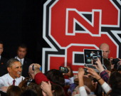 President Barack Obama greets well wishers as he enters the JW Isenhour Tennis Center on the campus of NC State University in Raleigh NC Wednesday...
