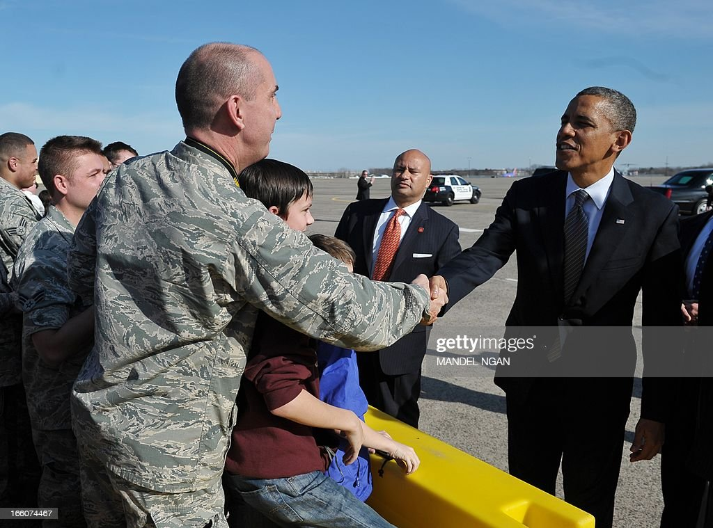 US President Barack Obama greets well-wishers upon his arrival at Bradley Air National Guard Base in Hartford, Connecticut on April 8, 2013. Obama is in Hartford to speak on gun control at the University of Hartford. AFP PHOTO/Mandel NGAN