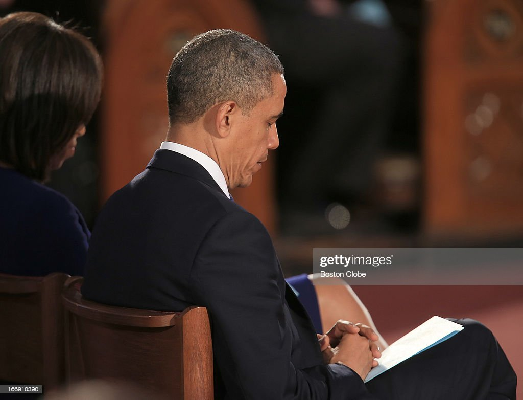 President Barack Obama, hands in prayer, and his wife, Michelle Obama, attended a service called 'Healing Our City: An Interfaith Service,' at the Cathedral of the Holy Cross for the victims of the Boston Marathon bombings in Boston, Mass. on Thursday, April 18, 2013.