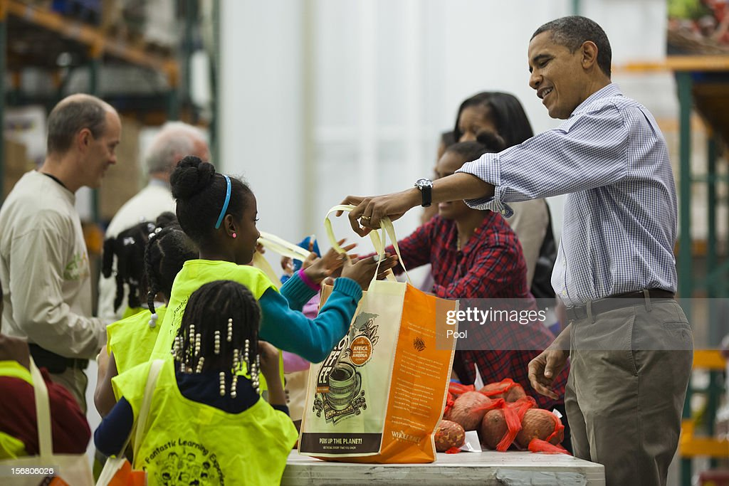 U.S. President <a gi-track='captionPersonalityLinkClicked' href=/galleries/search?phrase=Barack+Obama&family=editorial&specificpeople=203260 ng-click='$event.stopPropagation()'>Barack Obama</a> hands out food to the needy for Thanksgiving at the Capitol Area Food Bank on November 21, 2012 in Washington, DC. President Obama also marked the Thanksgiving holiday today with the traditional Thanksgiving turkey pardon at the White House.