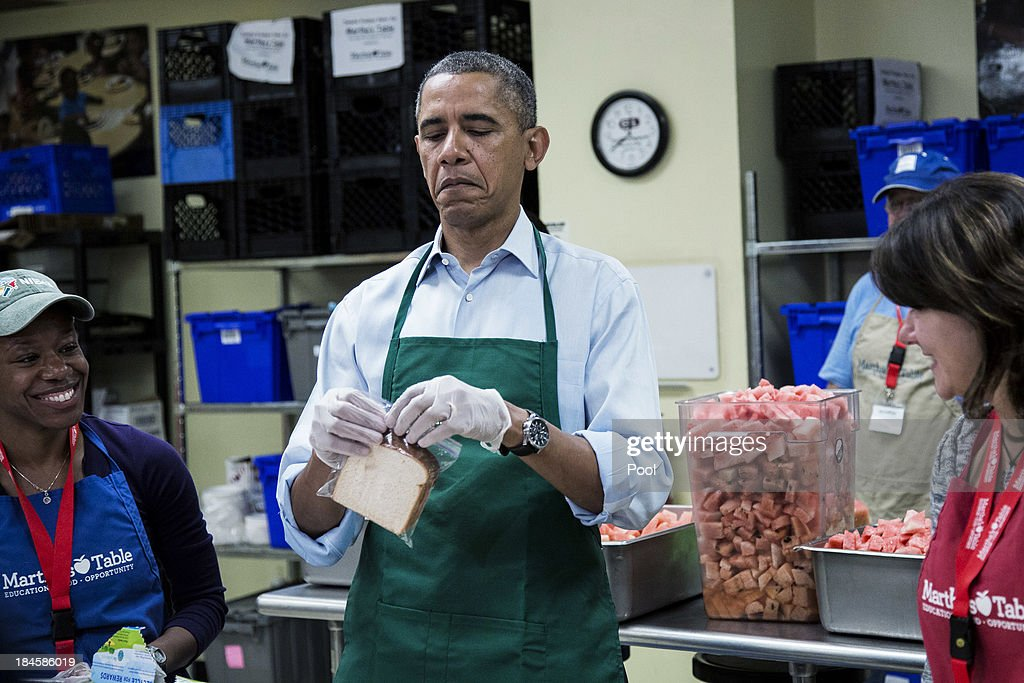 U.S. President <a gi-track='captionPersonalityLinkClicked' href=/galleries/search?phrase=Barack+Obama&family=editorial&specificpeople=203260 ng-click='$event.stopPropagation()'>Barack Obama</a> (C) helps bag sandwiches with furloughed federal workers Health and Human Services employee Chantelle Burton (L) and U.S. Census Burea employee Dolly Garcia, while they volunteer at a Martha's Table kitchen on October 14, 2013 in Washington, D.C. During a statement, Obama called on congress to end the budget stalemate and allow federal employees to return to work.