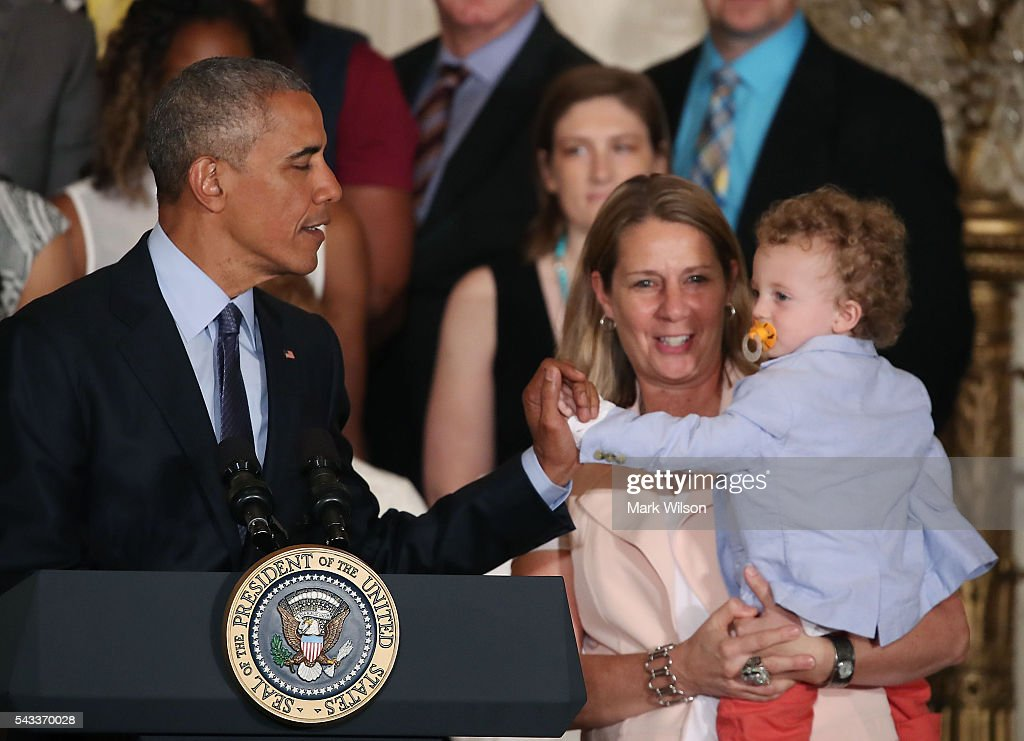 US President <a gi-track='captionPersonalityLinkClicked' href=/galleries/search?phrase=Barack+Obama&family=editorial&specificpeople=203260 ng-click='$event.stopPropagation()'>Barack Obama</a> high fives Coach Cheryl ReeveÕs son Oliver, during an event to honor the Minnesota Lynx team for its 2015 WNBA championship victory, in the East Room at the White House June 27, 2016 in Washington, DC.