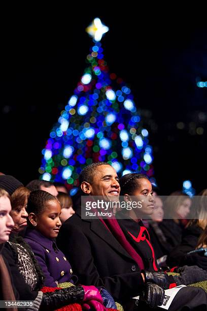 President Barack Obama his daughters Sasha Obama and Malia Obama along with motherinlaw Marian Robinson attend the 2011 National Christmas Tree...