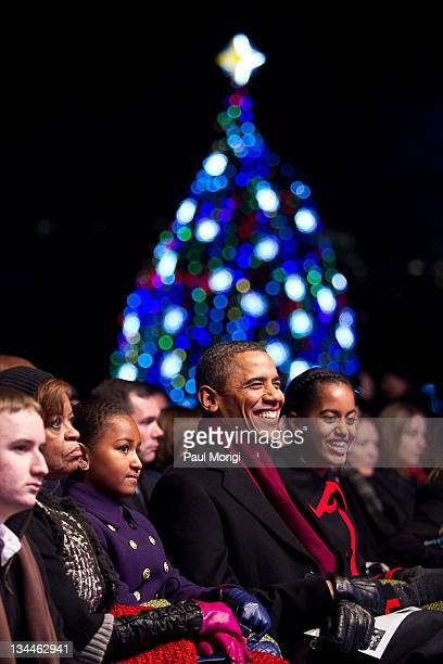 President Barack Obama his daughters Sasha Obama and MaliaObama along with motherinlaw Marian Robinson attend the 2011 National Christmas Tree...
