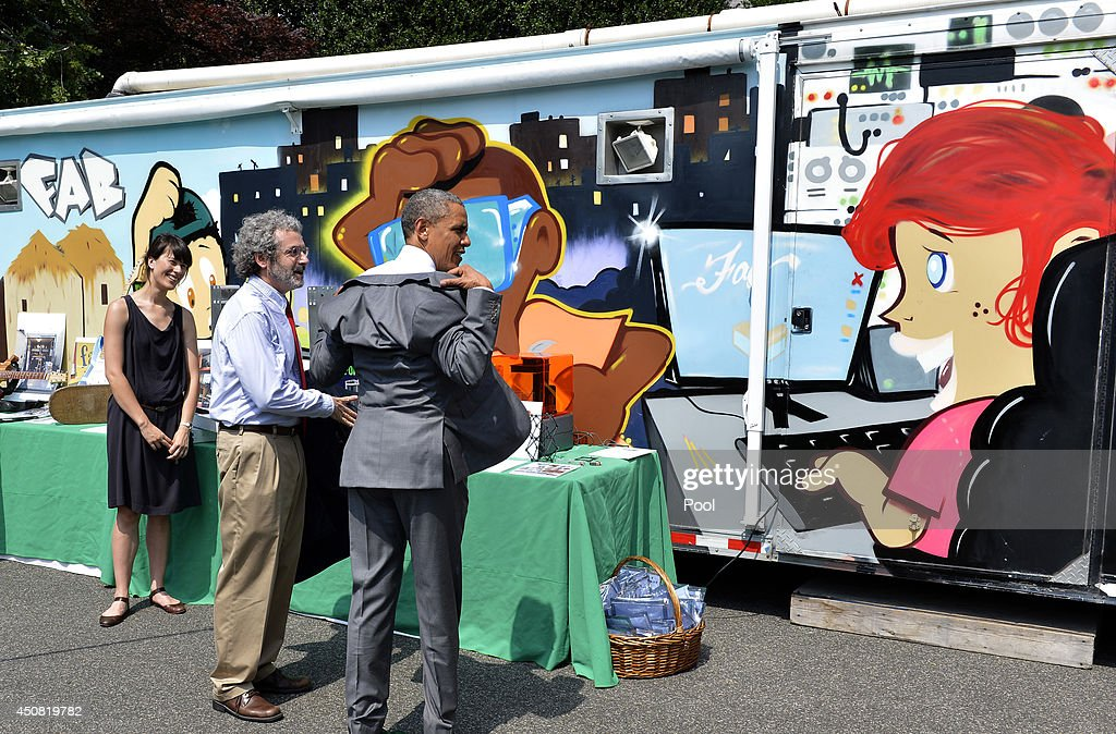U.S. President Barack Obama his takes off suit coat in record-setting heat as he visits the Massachusetts Institute of Technology's 'Mobile Fab Lab', at the White House Maker Faire on the South Lawn June 18, 2014 in Washington, DC. The Faire is a series of projects by students, entrepreneurs and regular citizens using new technologies and tools to launch new businesses and learning new skills in science, technology, engineering and mathematics.