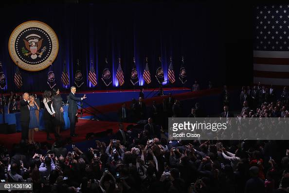 President Barack Obama his wife Michelle and daughter Malia and Vice President Joe Biden and his wife Jill greet guest following Obama's farewell...