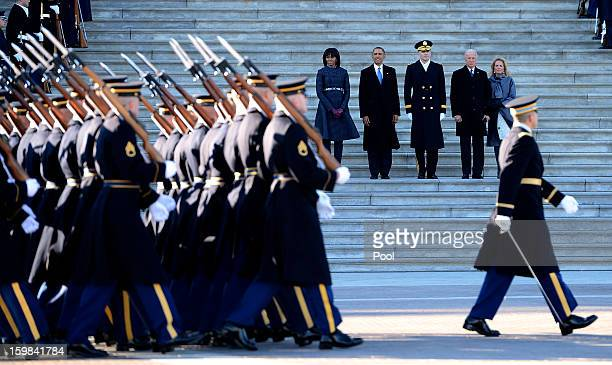 S President Barack Obama his wife Michelle Obama Vice President Joe Biden and his wife Dr Jill Biden and US Army Maj Gen Michael J Linnington watch...