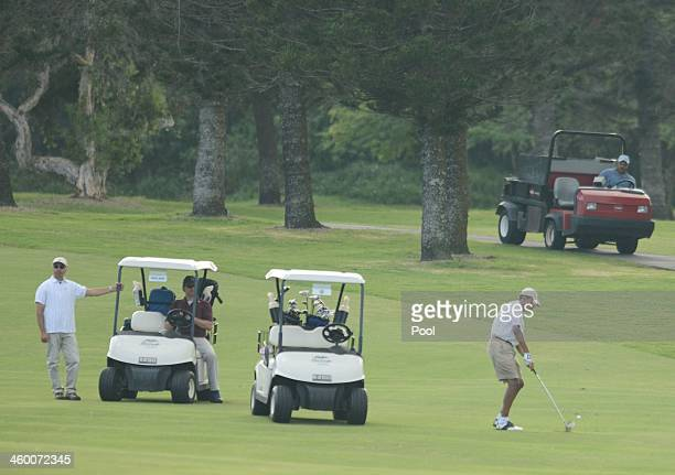 S President Barack Obama hits ball on the fairway on the approach to the 18th hole at the Mid Pacific Country Club on January 1 2014 in Lanikai...