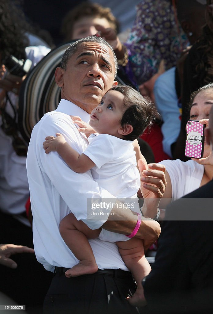 U.S. President <a gi-track='captionPersonalityLinkClicked' href=/galleries/search?phrase=Barack+Obama&family=editorial&specificpeople=203260 ng-click='$event.stopPropagation()'>Barack Obama</a> holds a baby as he greets people during a campaign rally at the Delray Beach Tennis Center on October 23, 2012 in Delray Beach, Florida. Obama continues to campaign across the U.S. in the run-up to the November 6, presidential election.